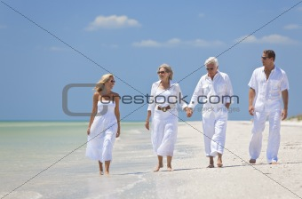 Two Couples Generations of Family Walking on Tropical Beach