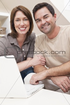 Happy Couple Using Laptop Computer at Home