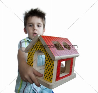 Boy presenting wood colorful house toy