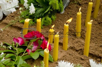 Candles on the grave.
