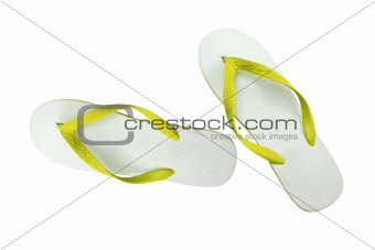 pair of yellow flip-flops isolated on a white background