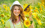 Beauty teen girl and sunflowers