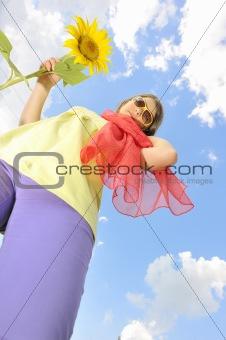 Beauty teen girl and sunflowers