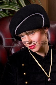 blond woman in an elegant hat