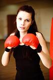 Expressive portrait of woman boxer.