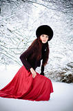 Pretty woman goes on snow