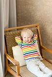 toddler lying in the chair