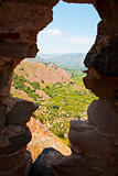 view on lands through gun slot in old Arab-Norman fortress