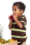 Child Eating Apple from Grocery Bag  Isolated on White Background