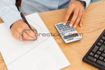 Hands of an accountant making a report