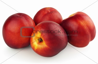 Four nectarines isolated on white