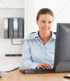 Close up of an office worker typing on a keyboard
