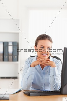 Office worker looking at her computer
