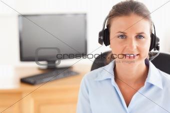 Office worker wearing a headset posing