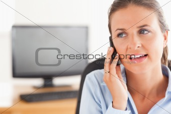 Cute working woman speaking on the phone