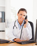 Portrait of a serious female doctor on the phone