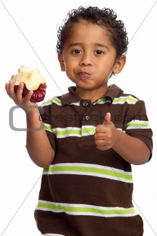 Toddler Eating Apple and Giving Thumb Up Isolated on White Background
