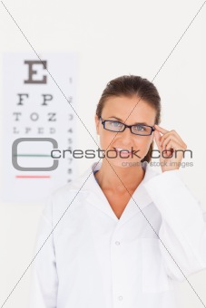 Eye specialist wearing glasses looking into the camera