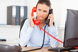 Businesswoman telephoning with two devices