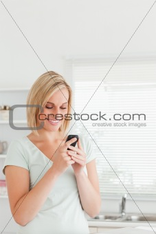 Cute woman with a mobile