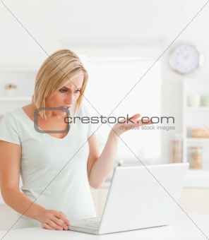 Angry woman looking at notebook without having any clue what to