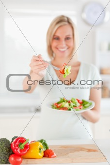 Beautiful woman offering salad