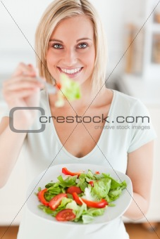Charming woman offering salad