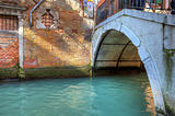 Small bridge over canal in Venice.