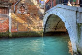 Small bridge over canal in Venice.