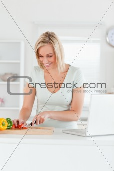 Blonde woman cutting peppers