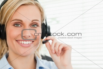 Close up of a smiling businesswoman with headset looking