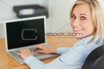 Blonde businesswoman smiling into camera