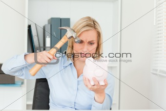 determined woman wanting to destroy her piggy bank