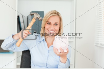 Expectantly woman wanting to destroy her piggy bank