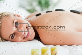 Blonde woman having a stone therapy