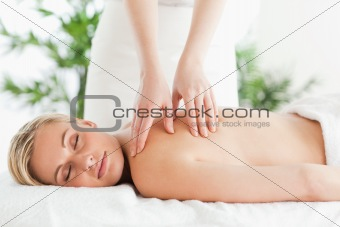Blonde woman relaxing on a lounger during massage