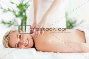 Cute woman relaxing on a lounger during massage
