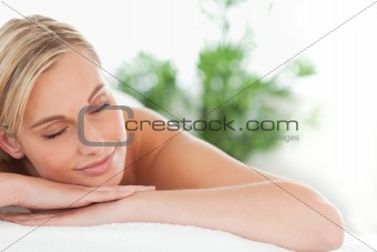 Close up of a woman lying on a lounger eyes closed