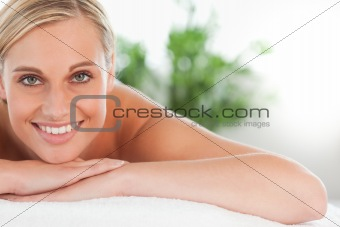 Close up of a smiling woman relaxing on a lounger