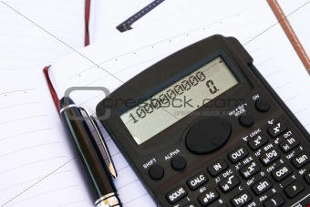Calculator, pen and notebook