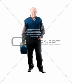 Confident man standing with toolbox in right hand