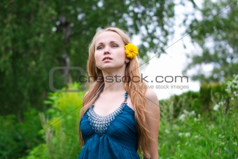 young woman with a yellow flower in her hair