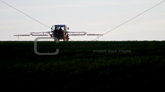 tractor spraying agricultural pesticide