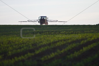 tractor with pesticide on field