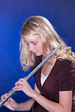 Flute Player Isolated on Blue