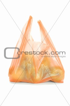 Green apples in plastic bag