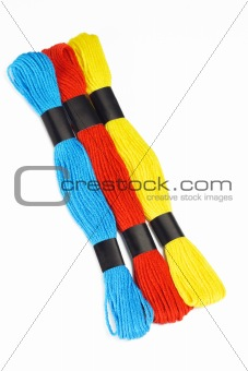 Three colorful embroidery threads