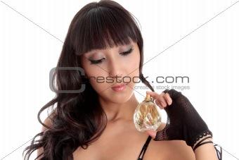 Sensual woman holding perfume