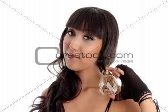 Beautiful woman holding perfume fragrance