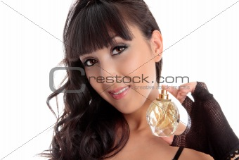 Attractive woman holding perfume